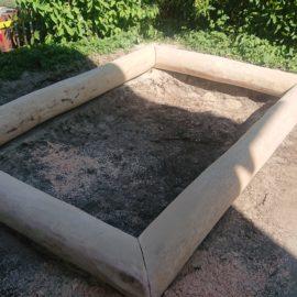 Erstellen eines Sandkasten aus Eschenrundholz